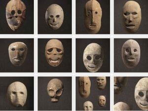 12 image of various stone masks with hollow eyes and no hair.  Each has different facial features and expressions. Most have teeth carved into the mouth