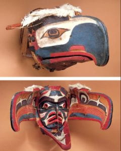 Red, white, and blue eagle head mask that opened in the center of the beak to reveal a human-like face of the same color pattern