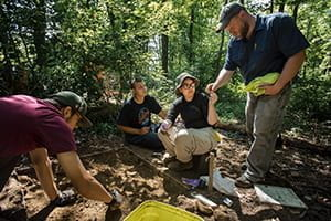 Photo of Dr. Ben Ford with students at dig site in Blairsville.