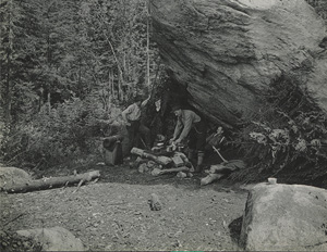 Three men making camp at Slant Rock on the Johns Brook trail up Mount Marcy, NY, June 1920.