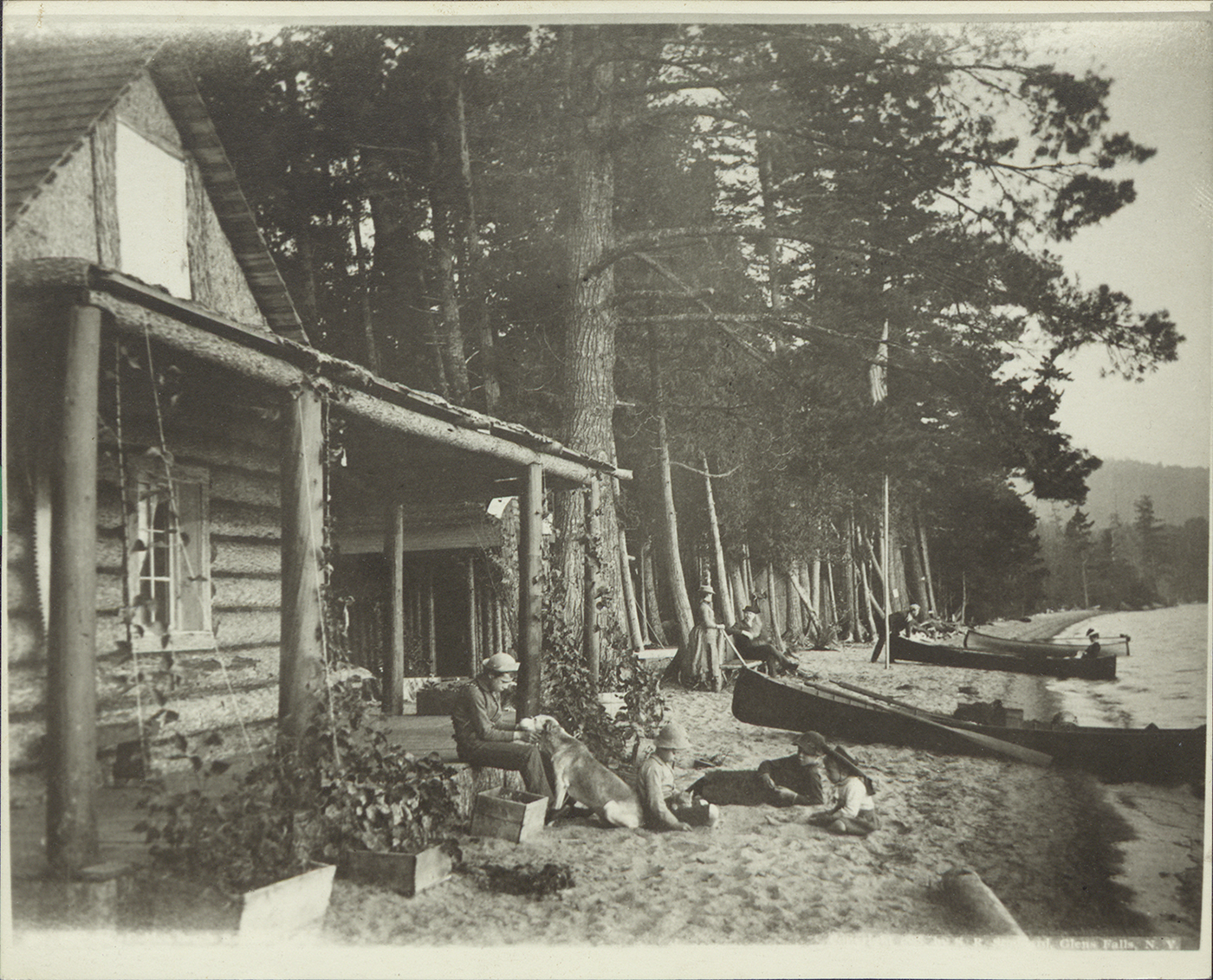 Campers on Golden Beach on Raquette Lake, NY, circa 1900.
