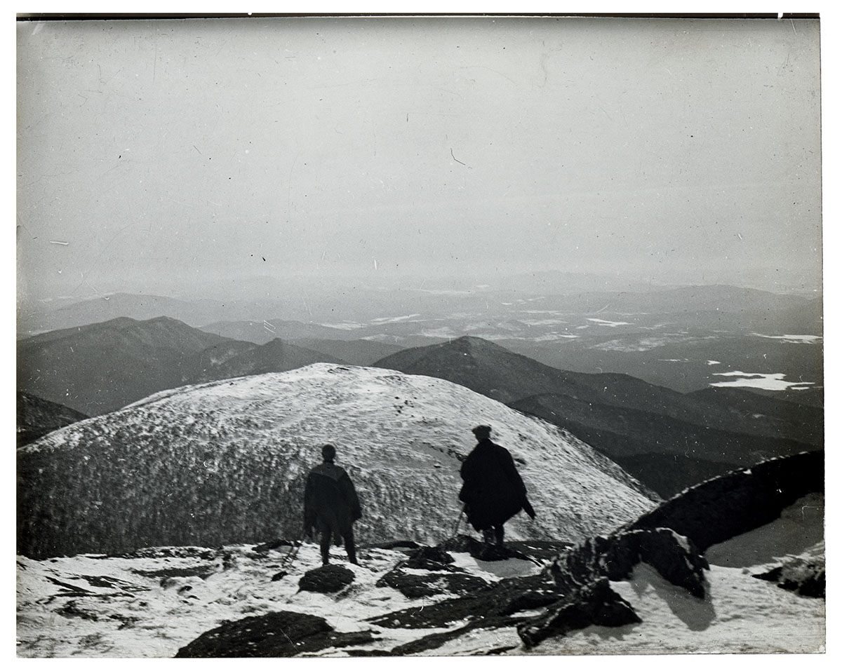 John S. Apperson Jr. and Dr. Irving Langmuir looking out over the Adirondack Mountains from the summit of Mount Marcy, NY in 1912.