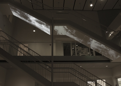 Georgie Friedman, Slippery Slope, 2016, two-channel site-specific video installation, 30 feet 7 inches x 4 feet, 6:40 min (loop, no audio), Wold Center, Union College