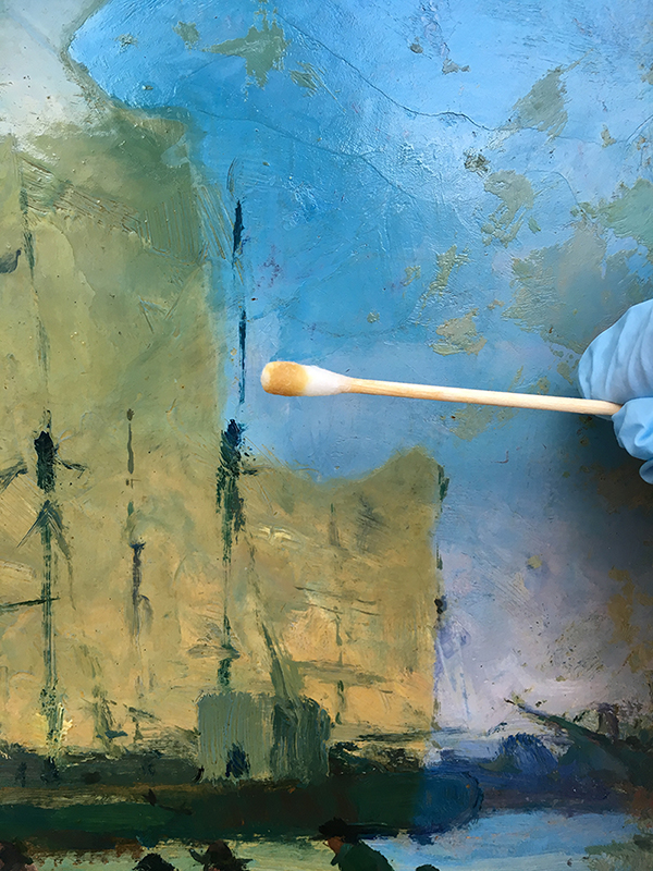 This image shows the varnish being removed from the painting as it is cleaned during conservation. This treatment is made possible as part of the Adopt an Artwork Program by a donation from Lawrence Fest, Union College Class of 1989.