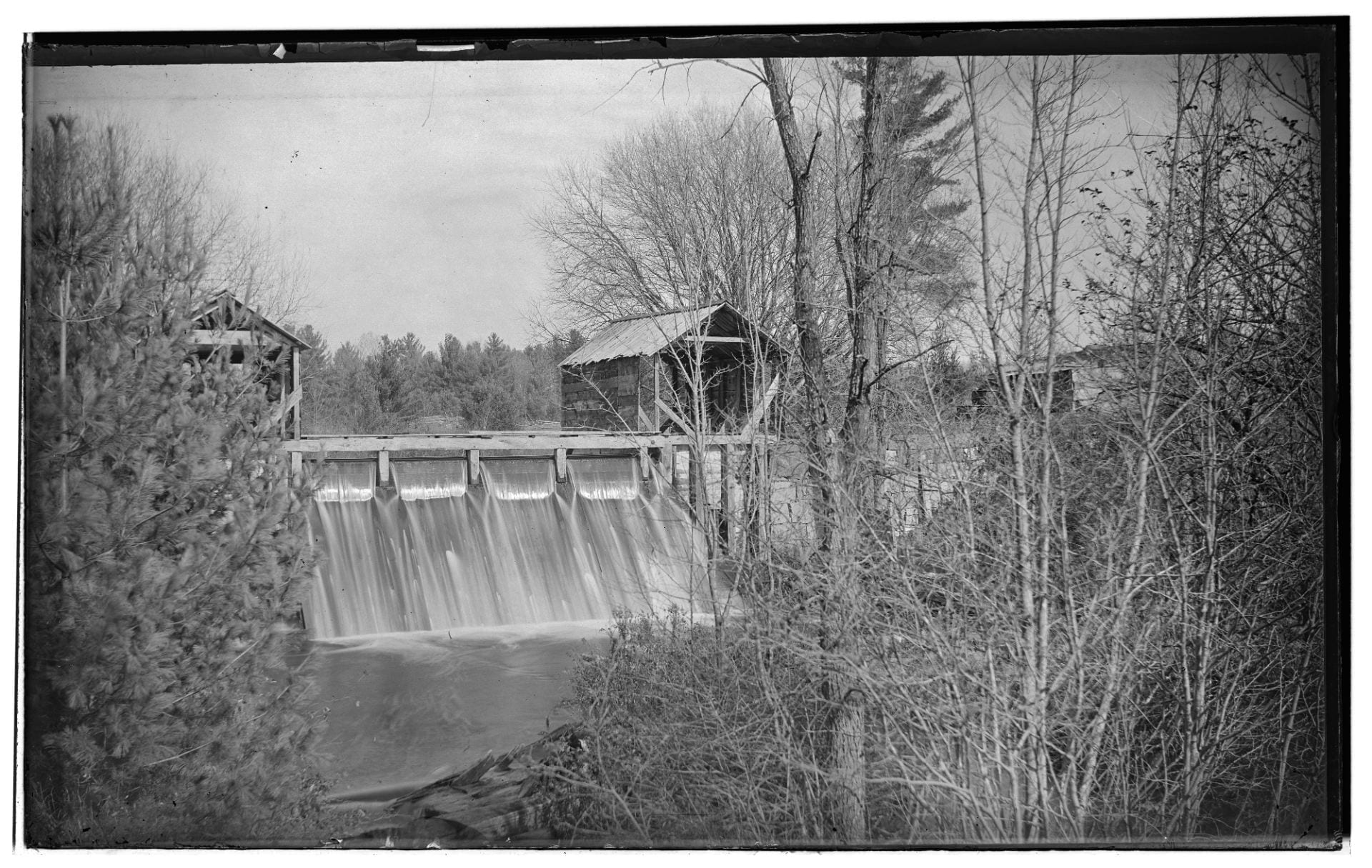 Image: water flowing over the dam