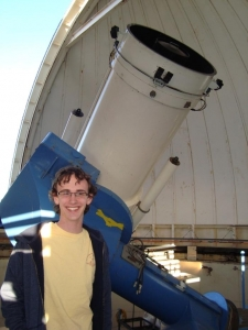 Michael Warrener '16 in the WIYN 0.9m Telescope dome at Kitt Peak National Observatory
