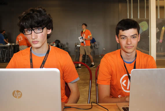 International School of the Americas students, Jackson Kohrs (left) and Wright Herndon (right) put their game faces on as they prepare to code their latest creation.