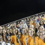 Picture of students from Madison cheer for the football team