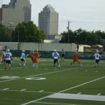 The Rattlers work together to score a goal.
