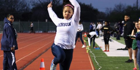 Junior Ira Frazier flies through the air for triple jump. Photo by Adelin Blackmon.