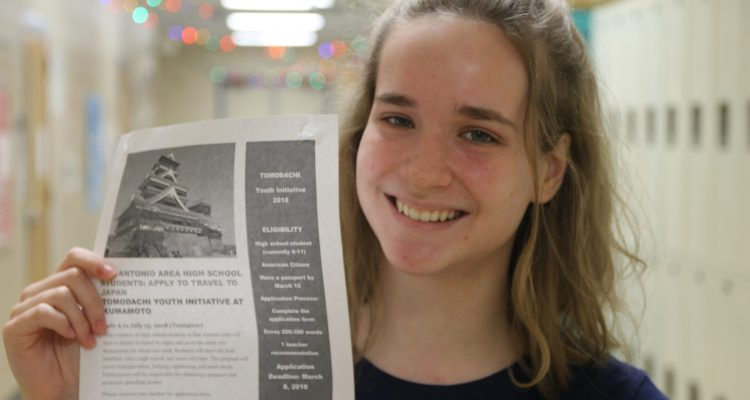 Sophomore, Lauren Loveless grabs a flyer for upcoming trip in summer to Japan.