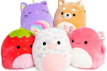 Collection of Squishmallows, including the strawberry, pig, axolotl, caticorn, and dog.