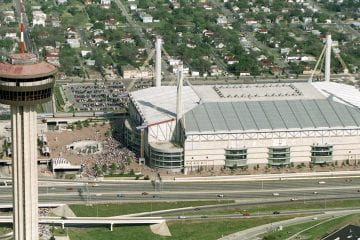 The Alamodome next to the Tower of Americas