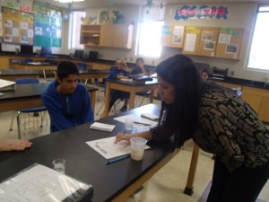 Mrs.Santos is helping her students