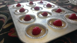 Place the raspberries in the batter with the open ends down, so that the insides don't dry out in the oven.