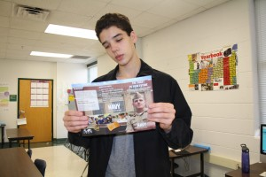 Daniel looking at the ROTC pamphlet. Photo by Vanessa Ramirez