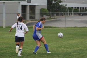 Junior Mary Cardone passing the ball. Photo by Jacob Dukes