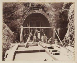 Hindi men constructing tunnel through mountain.