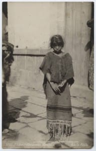 Indian girl stands in threadbare clothes (C.B. Waite, 1905) http://digitalcollections.smu.edu/cdm/singleitem/collection/mex/id/788/rec/121