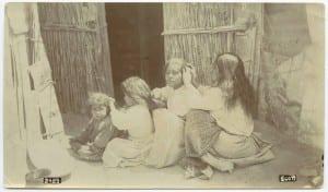 Three_girls_and_a_woman_checking_hair
