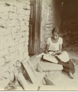 girl sewing on doorstep