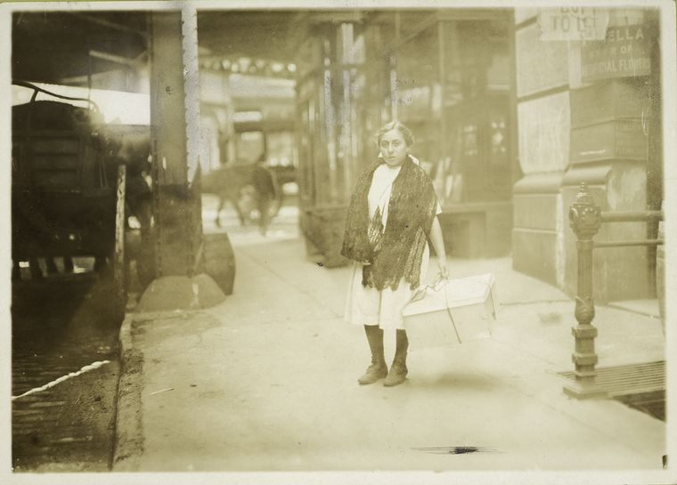 "The Miriam and Ira D. Wallach Division of Art, Prints and Photographs: Photography Collection, The New York Public Library. ""A young girl on West 3rd Street delivering flowers made at home during school hours"" The New York Public Library Digital Collections. 1907 - 1933. http://digitalcollections.nypl.org/items/510d47d9-4e05-a3d9-e040-e00a18064a99"