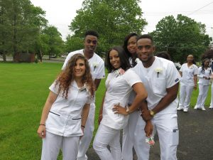 Nursing students pose at graduation