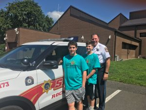 Camp students pose with Sheriff's vehicle