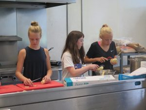 Culinary camp students prep food