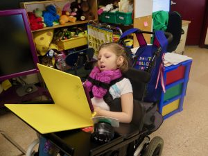 Kaplan girl in wheelchair working on her ipad