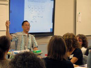 Greg Tang presents to educators.