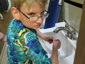 Max washing his hands