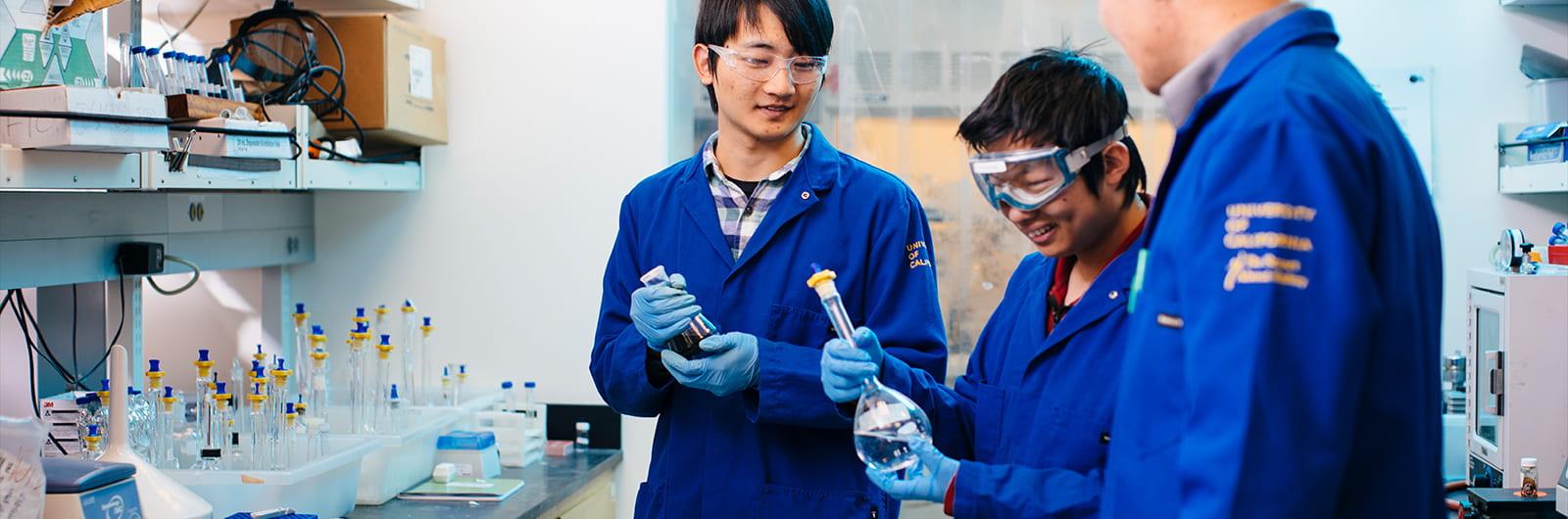 Chemist Shaowei Chen talks to students in lab, UCSC Science, photo credit Elena Zhukova 2019