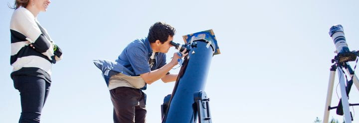 Astrophysics students look through telescope, photo credit Elena Zhukova for UC Santa Cruz 2012