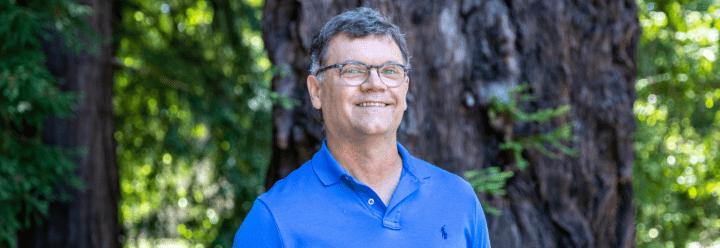 Photo of Scott Lokey in front of redwood trees