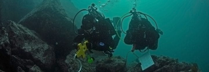 Photo of Kristy Kroeker's team research diving.