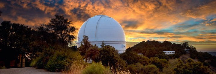 Photo of UCO Lick telescope at sunset by Willie Martini for UCO Lick.