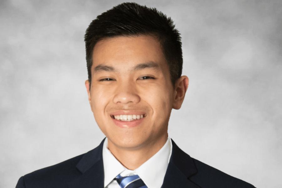 Portrait of Dan Nguyen in a suit and tie.