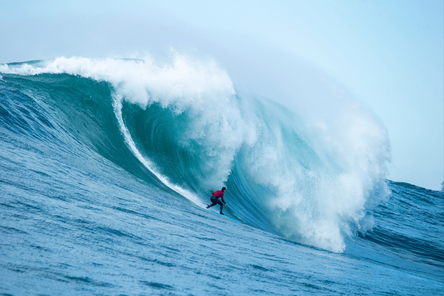 Image of a surfer riding a large wave.