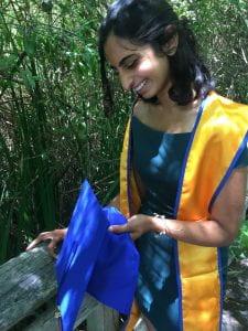 Ishana holding a graduation cap