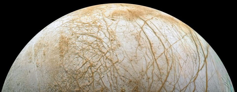 The Ice on Jupiter's Moon Europa Could Be Literally Glowing in The Dark, Study Hints