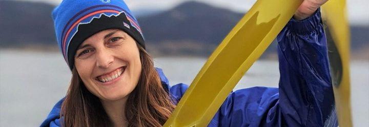 Photo of Roxanne Baltran holding a long piece of kelp.