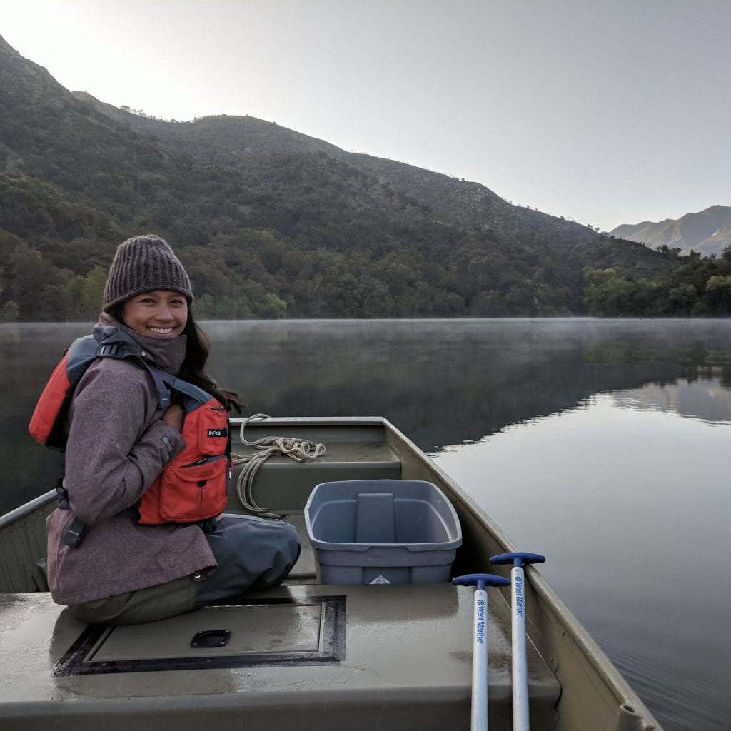 Dereka Chargualaf smiling on a boat in the Carmel River