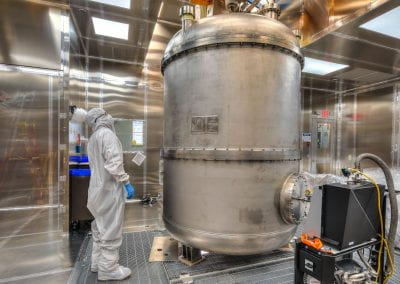 A photo of LZ's inner cryostat standing in the surface lab cleanroom at SURF.