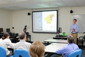 Student presenting GIS project for City of Orange officials.