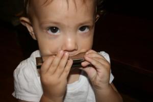 Ari playing the Marine Band G harmonica.