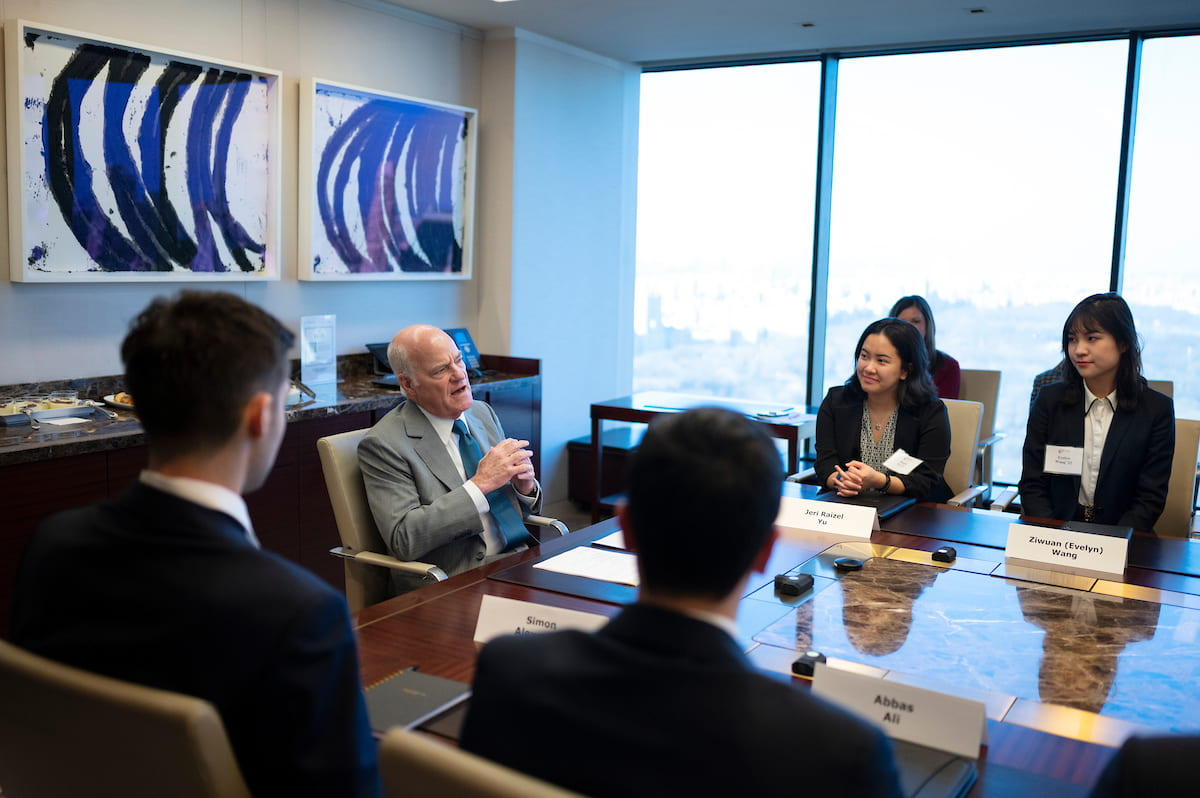 Students meeting with Henry Kravis
