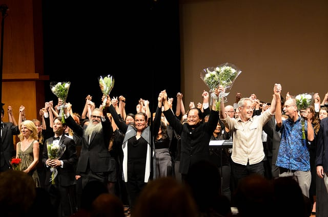 Performers receive standing ovation.
