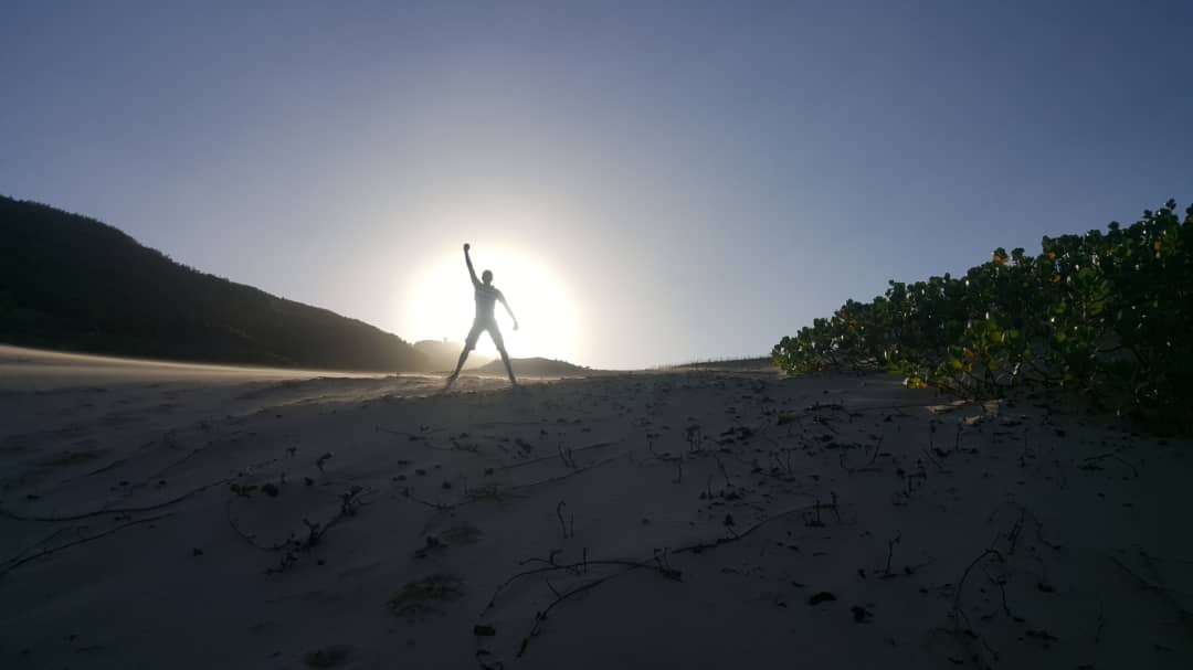 person's shadow standing in light of the sun