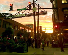 A photoof the sun setting over Ithaca Commons